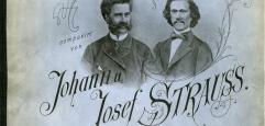 Titelblatt eines Musikdrucks: Schrift rund um zwei Portraits der Komponisten, grau-blauer Untergrund