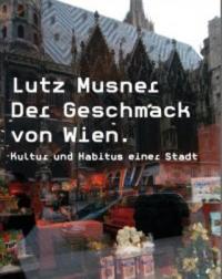 Farbphotographie: Auslage des Manner-Ladens, im Schaufenster spiegelt sich der Stephansdom